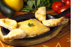 Flaming Saganaki with warm pita (Greek Cheese)